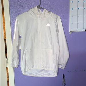 white reflective windbreaker